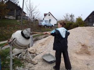 Caroline making cement